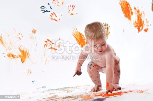 490853703 istock photo Happy Child Fingerpainting 176096807