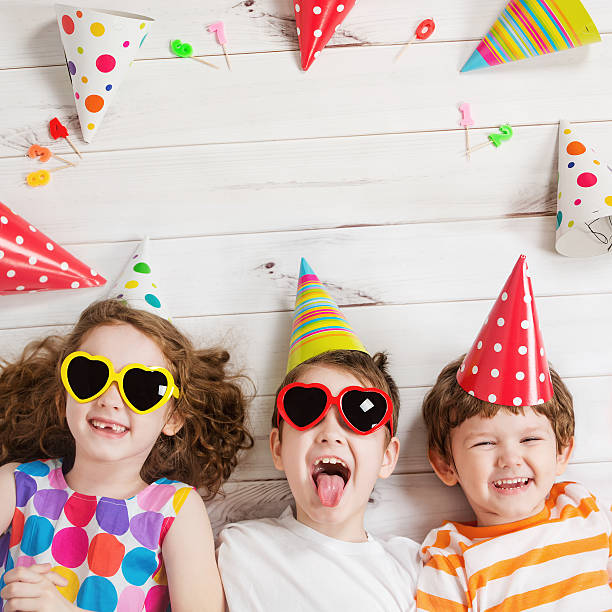 Happy child friend in carnival party. stock photo