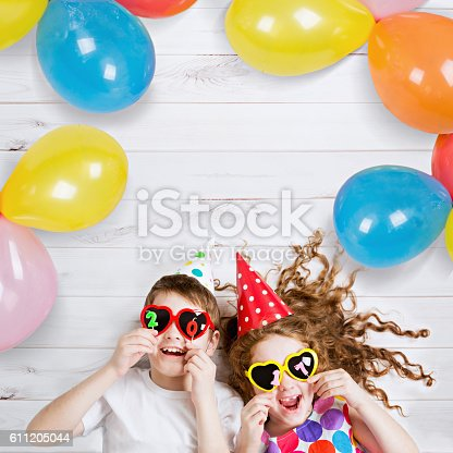 istock Happy child friend in carnival party. 611205044