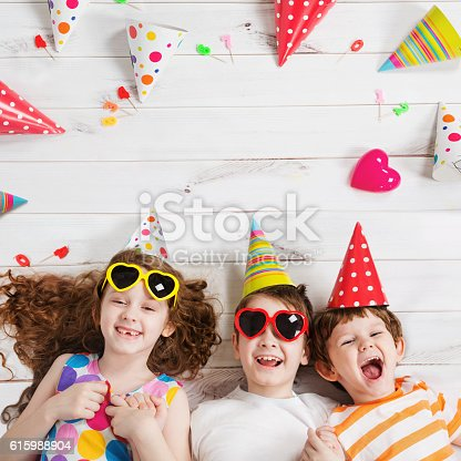istock Happy child friend in carnival party. 615988904