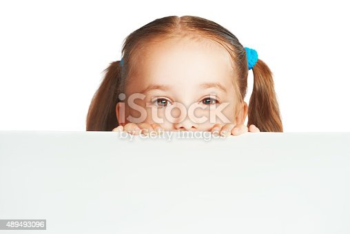 istock Happy child girl and blank white poster billboard 489493096