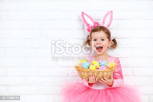 istock Happy child girl in a costume Easter bunny rabbit 511298154