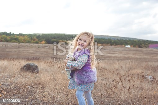 istock Happy child girl in autumn filed 612509820