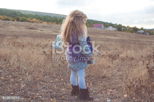 istock Happy child girl in autumn filed 612510212