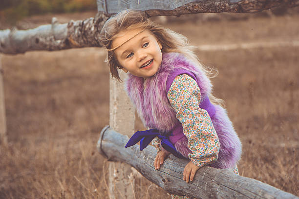 Happy child girl in autumn filed - Photo