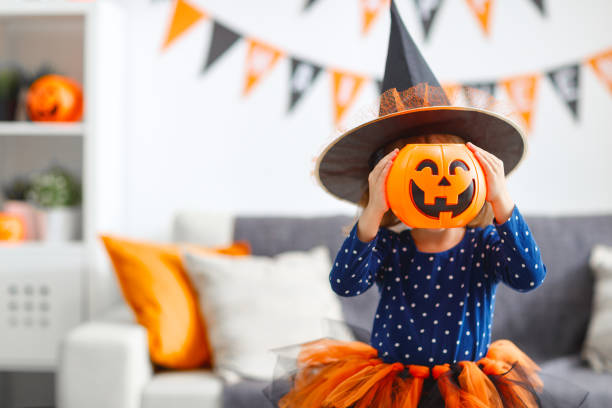 happy   child girl in witch costume to halloween - halloween стоковые фото и изображения