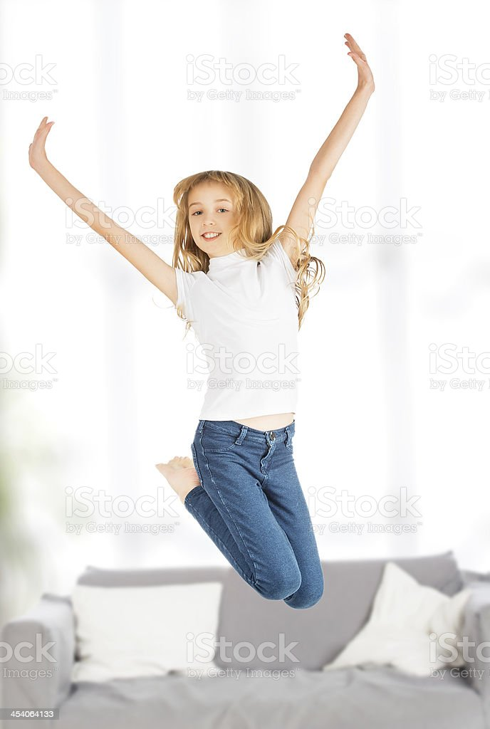 happy child girl jumping royalty-free stock photo