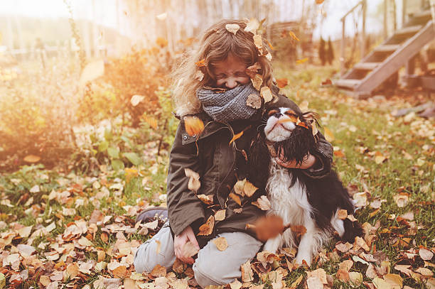 Happy child girl playing with her dog in autumn picture id610417878?b=1&k=6&m=610417878&s=612x612&w=0&h=f8iifgaon26kwsffr e0atc4ol7kuojlfdrx9cpda4m=