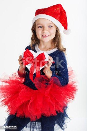 1061876006istockphoto Happy child girl with christmas gift box 496662020