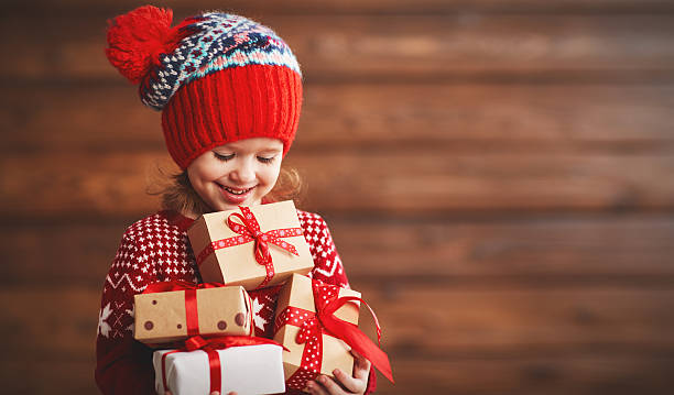 happy child girl with christmas present - christmas gift family bildbanksfoton och bilder
