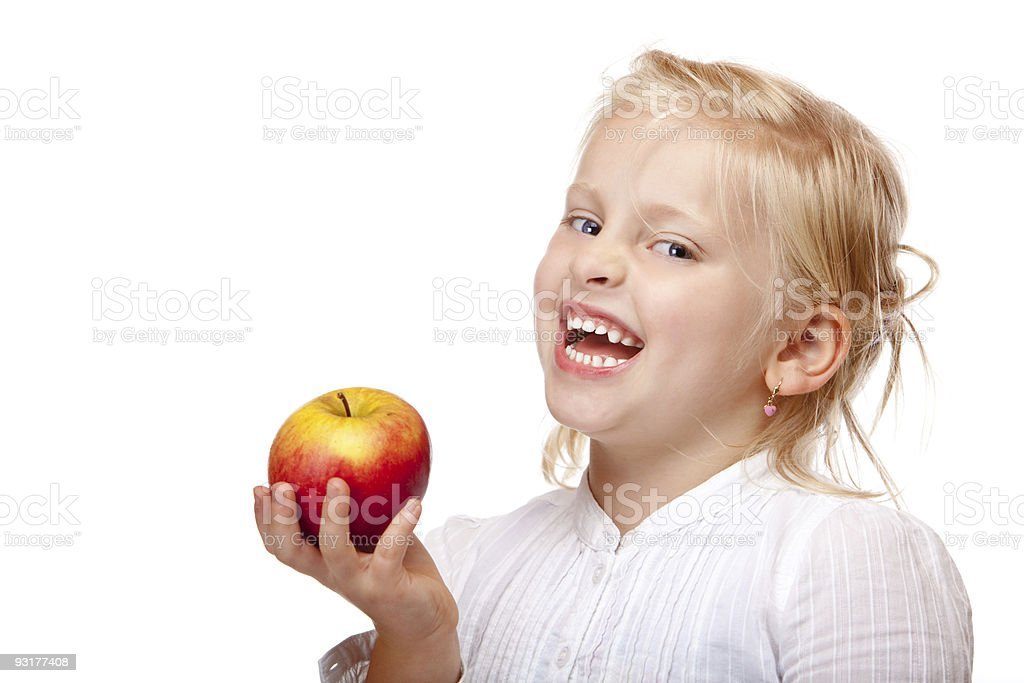 Happy child holds healthy fruit (apple) in hand royalty-free stock photo