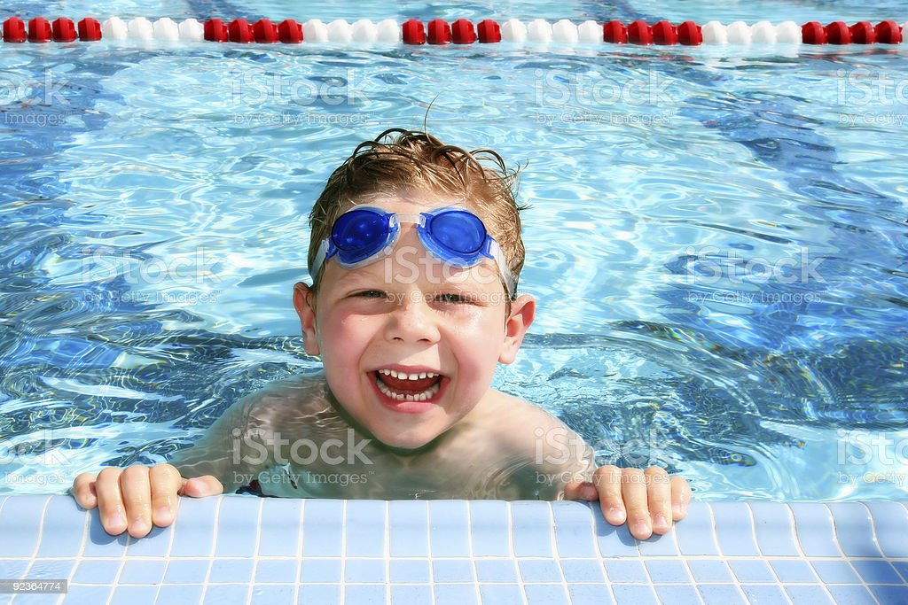Happy child in a swimming pool stock photo