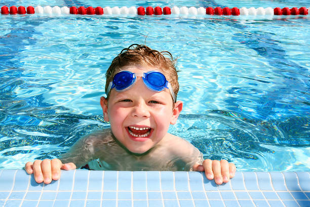 Happy child in a swimming pool  swimming goggles stock pictures, royalty-free photos & images