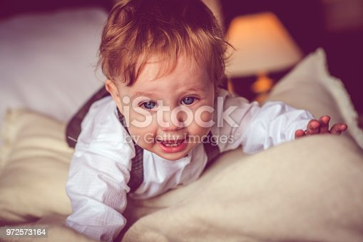istock Happy child in bed 972573164
