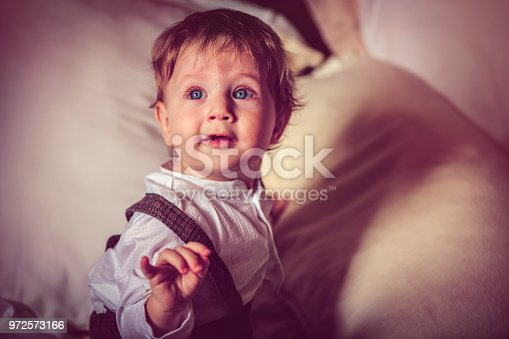 istock Happy child in bed 972573166