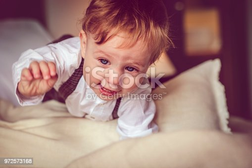 istock Happy child in bed 972573168
