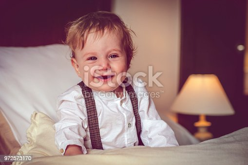 istock Happy child in bed 972573170