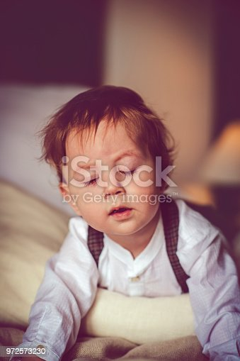 istock Happy child in bed 972573230