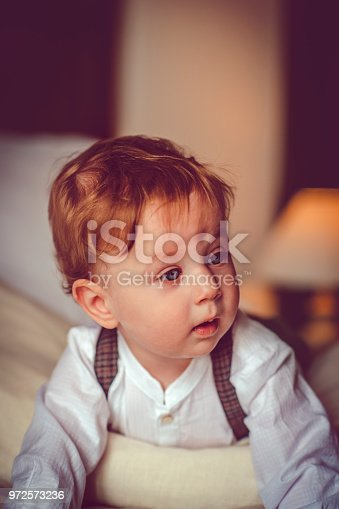 istock Happy child in bed 972573236