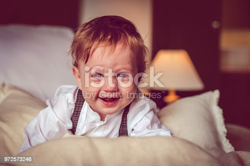 istock Happy child in bed 972573246