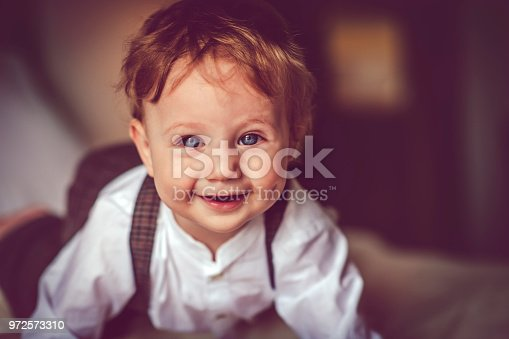 istock Happy child in bed 972573310