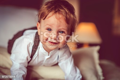 istock Happy child in bed 972573314