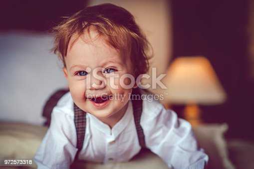 istock Happy child in bed 972573318