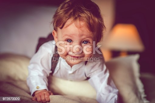 istock Happy child in bed 972573320