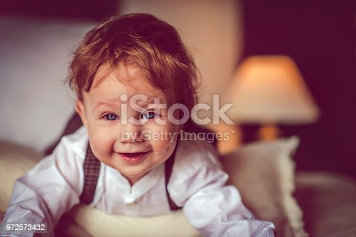 istock Happy child in bed 972573432