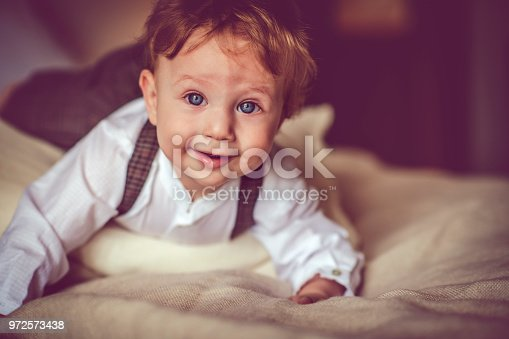istock Happy child in bed 972573438