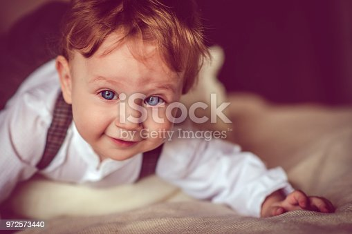 istock Happy child in bed 972573440