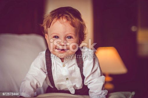 istock Happy child in bed 972573444
