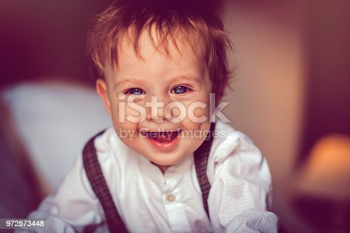 istock Happy child in bed 972573448