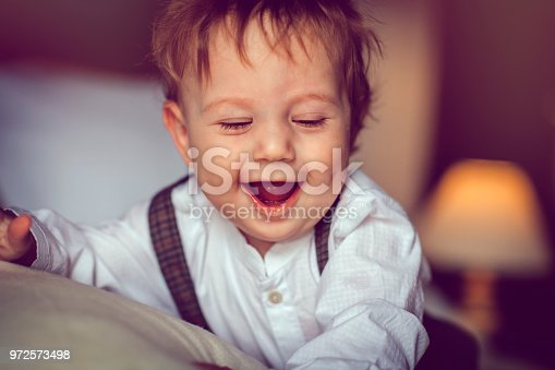 istock Happy child in bed 972573498