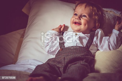 istock Happy child in bed 972575536