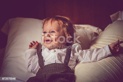 istock Happy child in bed 972575546