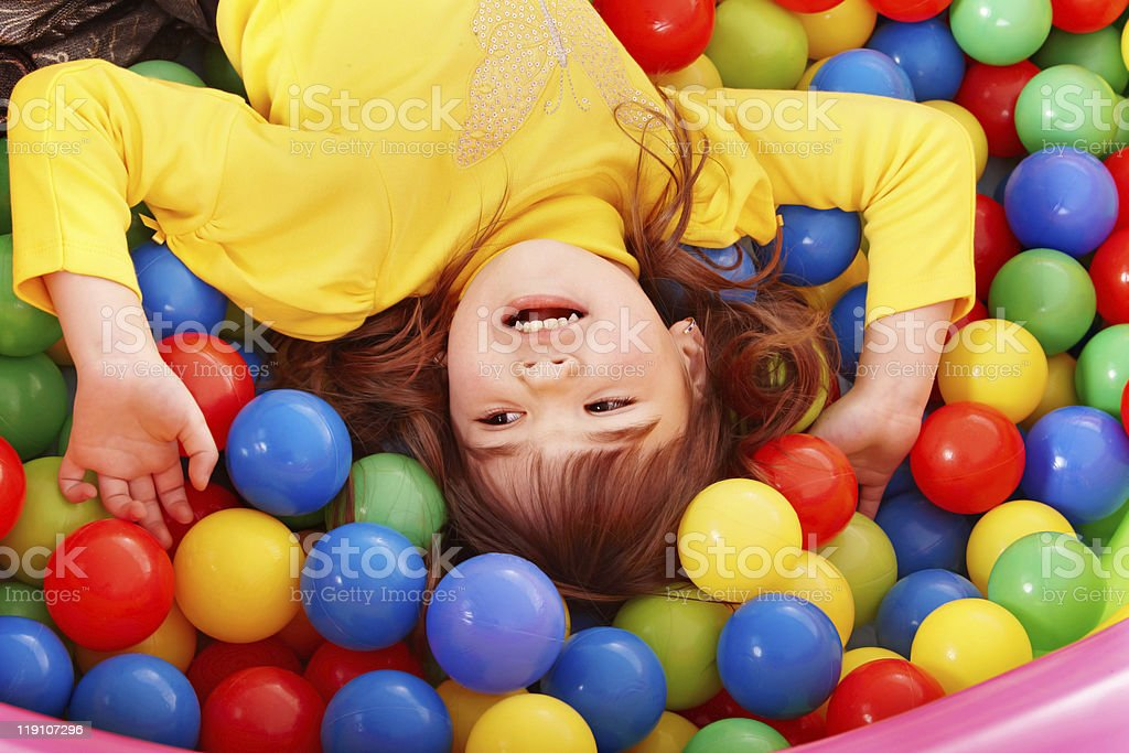 Happy child in group colourful ball. royalty-free stock photo