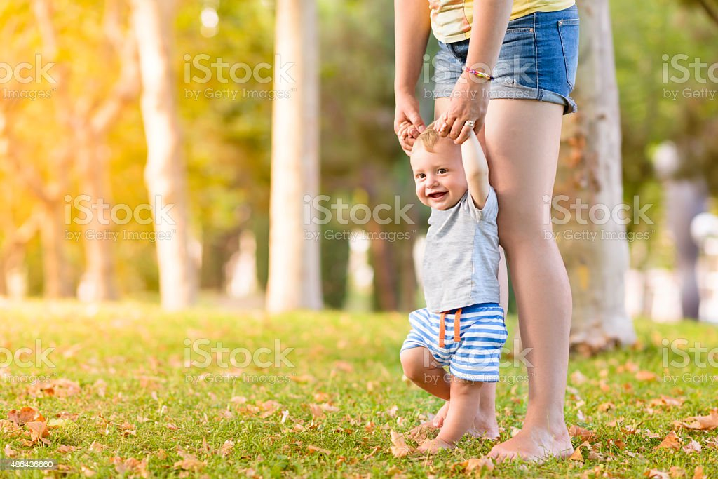 Happy Child Making First Steps stock photo