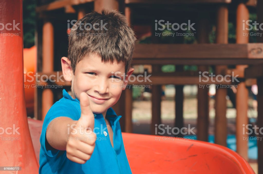 Happy child , ok with the hand stock photo