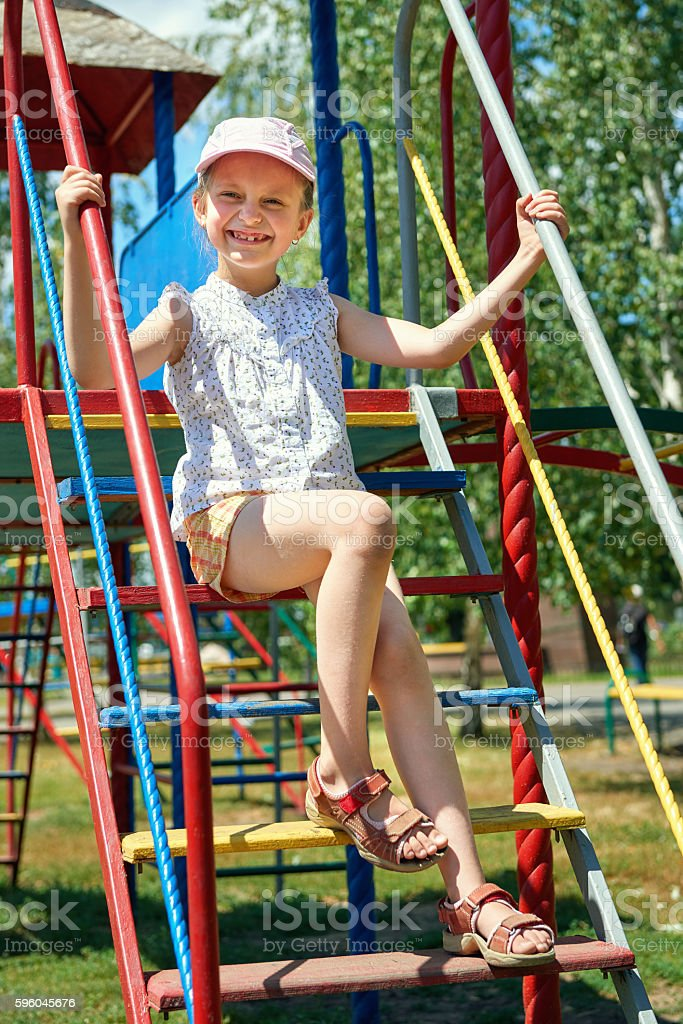 happy child on playground outdoor, play in city park royalty-free stock photo