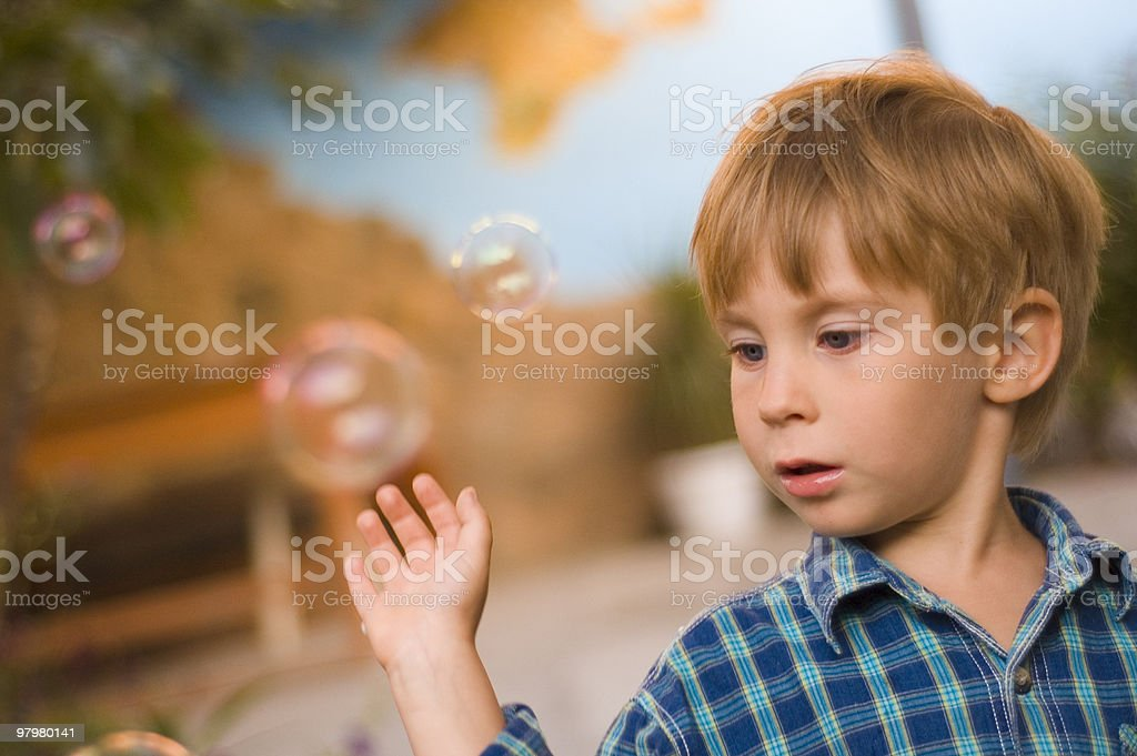 happy child play with soap bubbles outdoor royalty-free stock photo