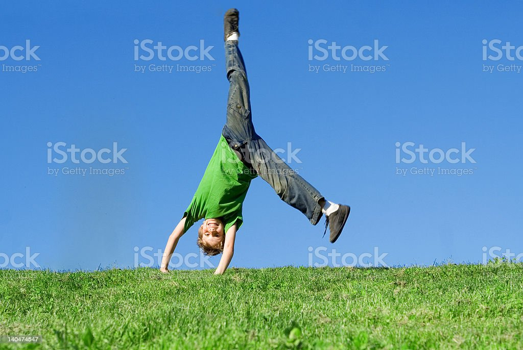 Happy child playing outdoors stock photo