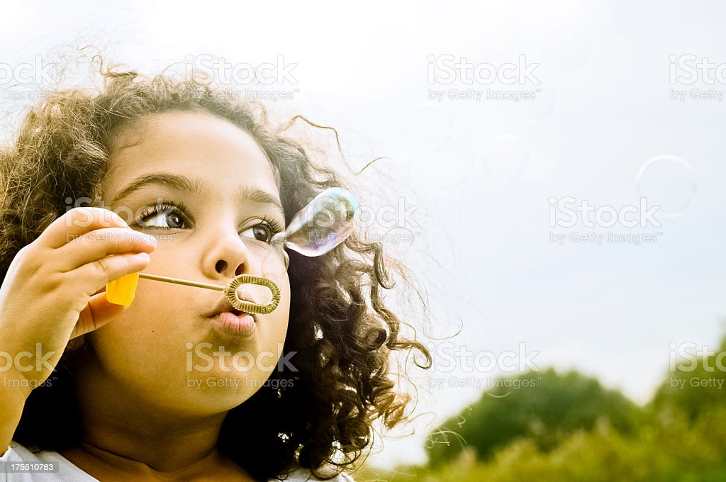 Happy Child (5-6) Playing with Bubbles Wand royalty-free stock photo