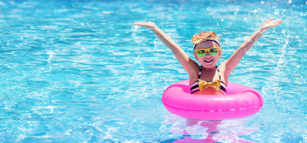 Happy Child Swimming In The Pool stock photo
