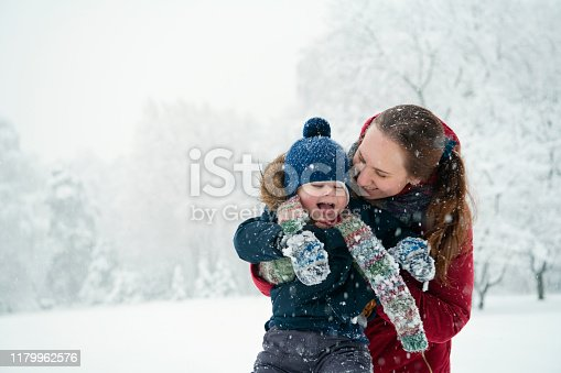 Little boy and mother in winter park