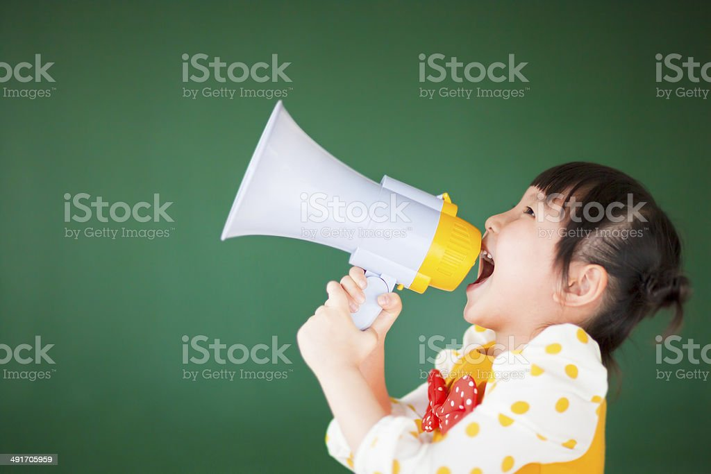 happy child  using a megaphone with blackboard stock photo
