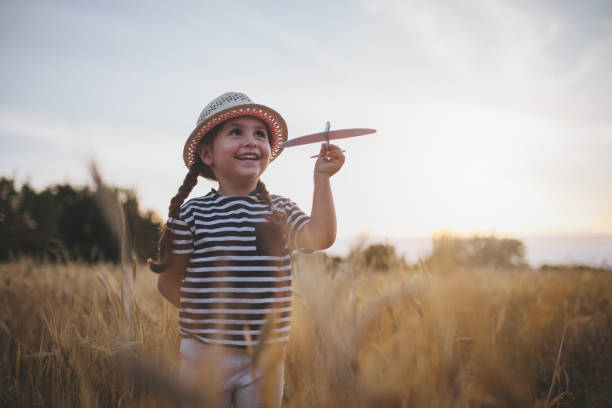 Happy child with a model airplane stock photo