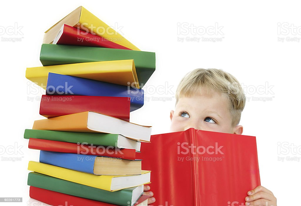Happy child with a pile of colorful books stock photo