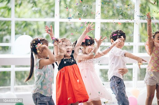 istock Happy child with Friendship in carnival party or Celebration Party birthday or New Year Christmas 1044553040