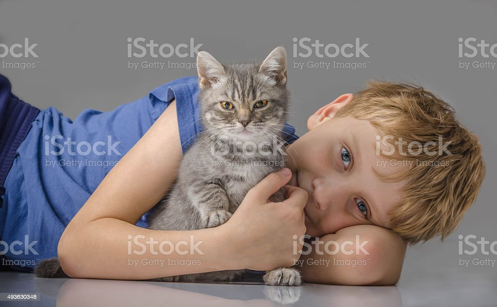 Happy child with kitten stock photo